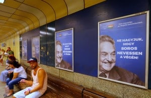 "Hungarian government poster portraying financier George Soros and saying ""Don't let George Soros have the last laugh"" is seen at an underground stop in Budapest, Hungary July 11, 2017. REUTERS/Laszlo Balogh"
