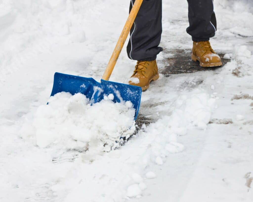 Shoveling snow in the cold outdoors
